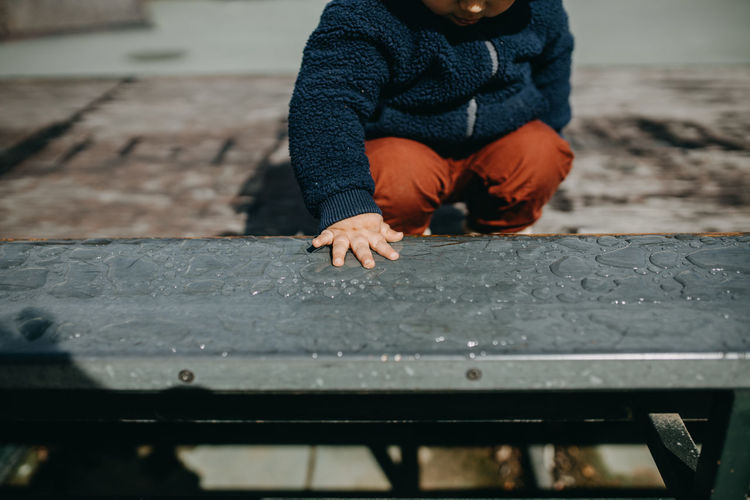 Full length of a boy on wood