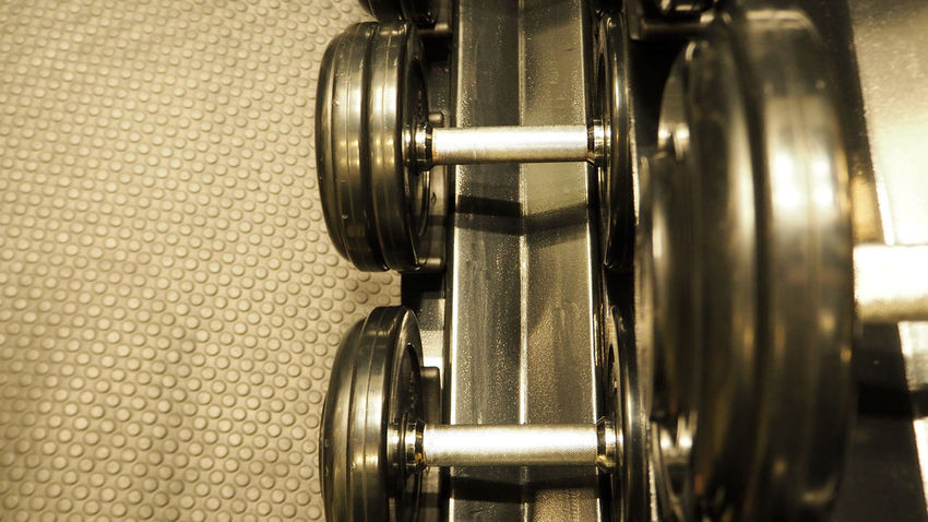 Dumbbells equipment in fitness. Equipment Fitness. Dumbbells E Exercise Fit Life  Lifting Work Out Close-up Dummbell Row Fitness, Background, Row, Dumbbells, Exercise, Heavy, Rack, Fit, Weight, Gym, Workout, Muscle, Lifting, Bodybuilding, Morning, Turquoise, Tint, Weights, Business, Text Gym Indoors  Metal Muscle Row Silver Colored Still Life Weight