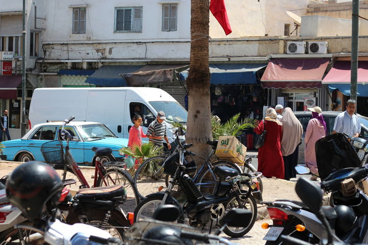Street in Agadir Mode Of Transportation Transportation Land Vehicle Group Of People Built Structure Real People Street Day Motorcycle City Building Exterior Motor Scooter Bicycle Outdoors Adult Architecture Scooter Agadir Morocco Streetphotography
