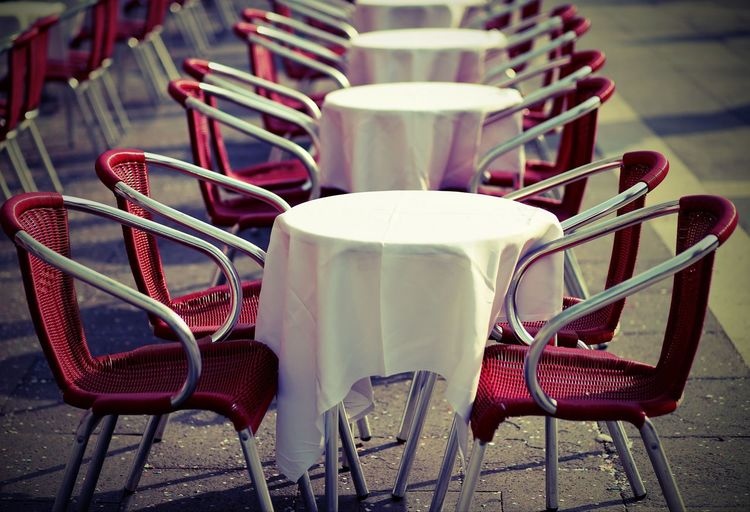 tables and red chairs in an alfresco cafe in the european city with vintage effect AlFresco Cafe AlFresco Coffee City Paris Square Absence Alfresco Bar Cafe Chair Citylife Empty Folding Chair Furniture Outdoors Parigi Red Restaurant Seat Sidewalk Cafe Table Tables Tavolini Trattoria Venice