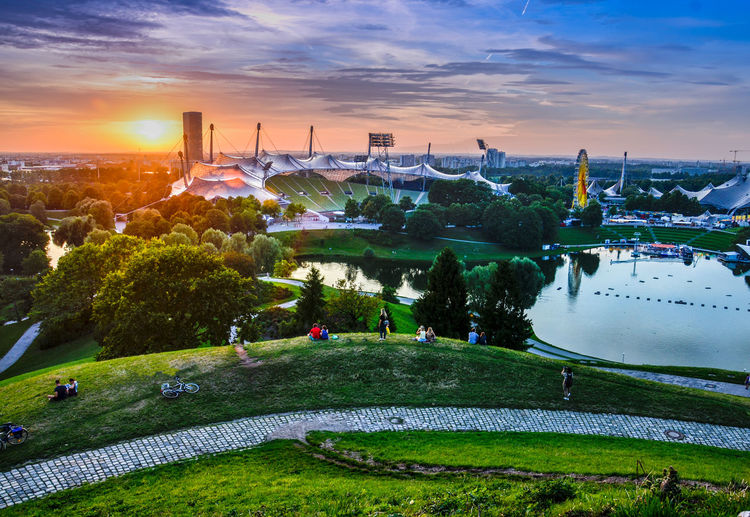 München Olympiapark Olympiastadion München Architecture Beauty In Nature Building Exterior Built Structure City Cityscape Cloud - Sky Day Modern Nature No People Olympiapark Olympiaparkmünchen Olympiastadion Outdoors Place Of Worship Sky Sunset Travel Destinations Tree Water
