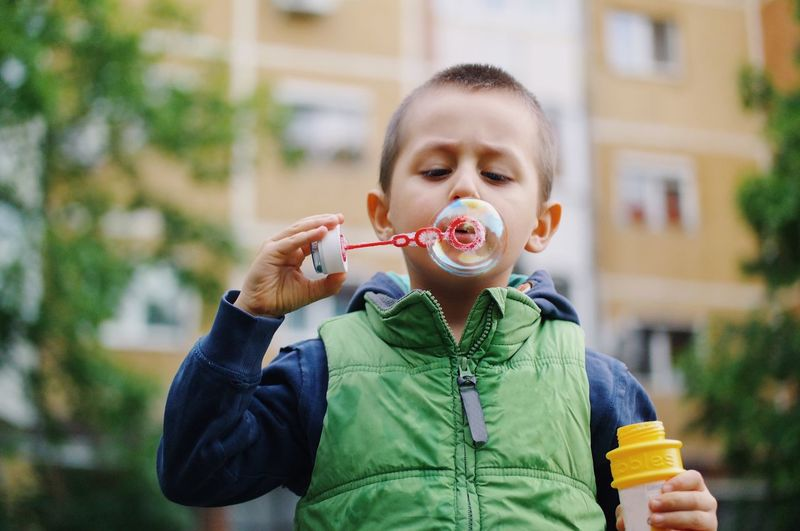 Bubble creation... Childhood Blowing Bubble Wand Front View Bubble Boys Holding Casual Clothing Leisure Activity Happiness Lifestyles Child Kid Kids Being Kids Details Of My Life My Favorite Photo VSCO Made In Romania Bubbles City Life City City Street Portrait Kids Playing Playtime The Portraitist - 2017 EyeEm Awards Fashion Stories