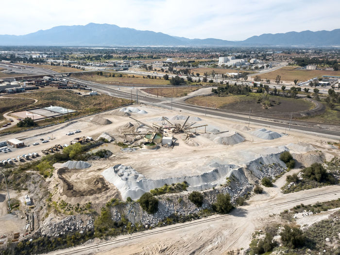 The CalPortland Aggregate plant in Colton Construction Industry Environment Road Day Nature Landscape Transportation Industry Land High Angle View Mining No People Mountain Outdoors Sky Scenics - Nature Architecture Quarry Concrete Aggregate Conveyors Industrial Cement