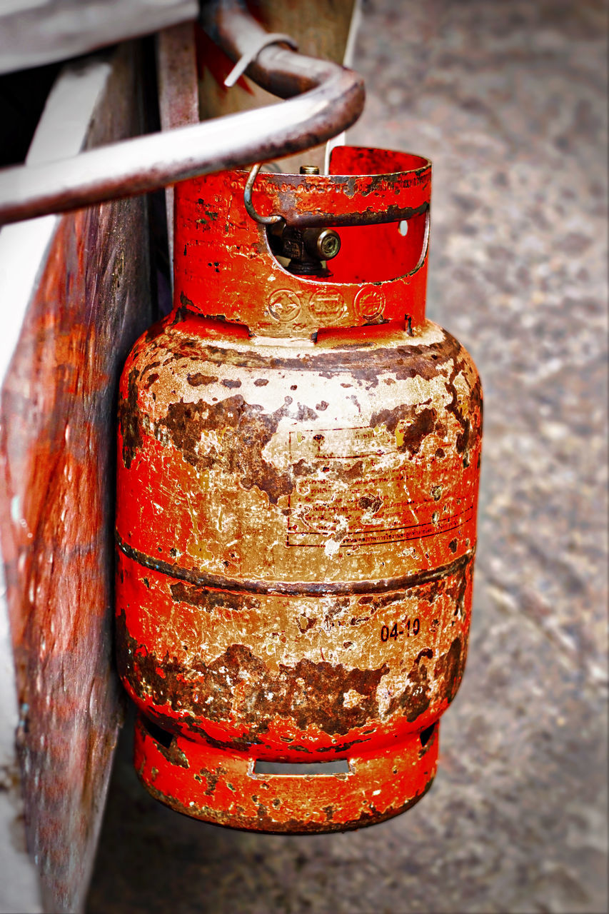 Character Composition Detail Focus On Foreground Gas Gas Cylinder Geometric Shapes Hanging Hazardous Metal Neglected Red Reflection Street Vendor Streetphotography Textures And Surfaces
