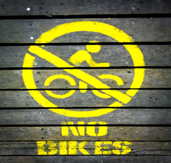 Boadwalk Close-up Communication Day No Bikes No People Outdoors Warning Sign Yellow