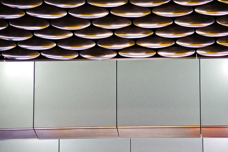 Architecture Protection Hanging Ceiling Airport Design Decoration Repetition Things I Like Pattern Closed Indoors  Metal Side By Side No People Photography In Motion In A Row Full Frame Geometric Shape Lighting Equipment Built Structure Wall - Building Feature Urban Spring Fever The Architect - 2016 EyeEm Awards Your Design Story Indoors  White Architectural Design Illuminated Close-up Day