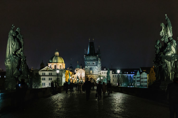 Prague Prague Czech Republic Night Prague Old Town Architecture Building Exterior Built Structure Place Of Worship Religion Spirituality City Belief Building Illuminated Group Of People Dome Real People Travel Destinations People Nature Rain Charles Bridge Charles Bridge, Prague Bridges Prague Bridge