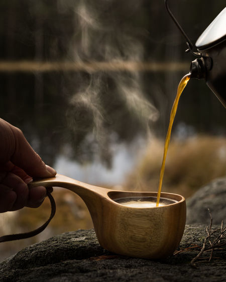 Close-up of hand pouring tea
