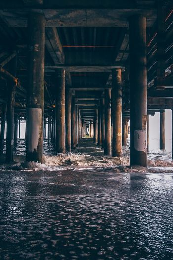 Beach Shore Architectural Column Architecture Built Structure Water No People Day Underneath Below Pier In A Row Indoors  Waterfront Building Connection Wet Nature Diminishing Perspective Abandoned Ceiling