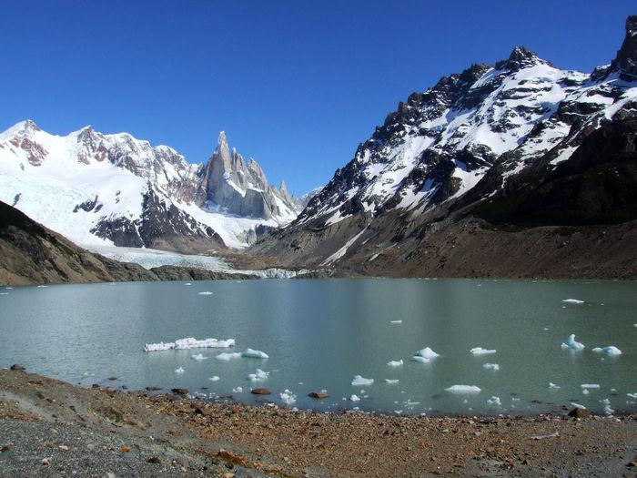 Cerro torre mountain range with glacier lake and icebergs, patagonia, argentina