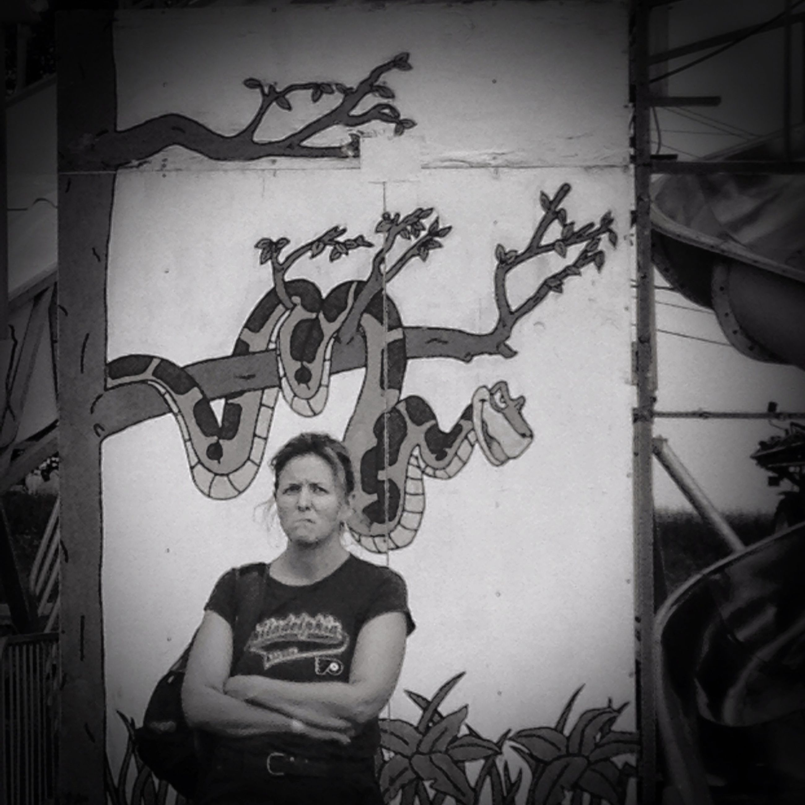 graffiti, lifestyles, young adult, person, casual clothing, wall - building feature, leisure activity, looking at camera, portrait, front view, young women, architecture, built structure, three quarter length, creativity, standing, indoors