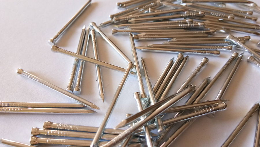 High Angle View Of Nails On Table
