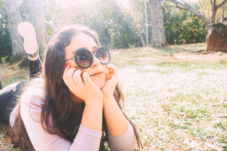 Camera - Photographic Equipment Day Discovery Exploration Happiness Headshot Holding Leisure Activity Looking Nature One Person Outdoors Photographer Photographing Portrait Real People Searching Smiling Sunlight Surveillance Technology Tree Vacations Watching Women
