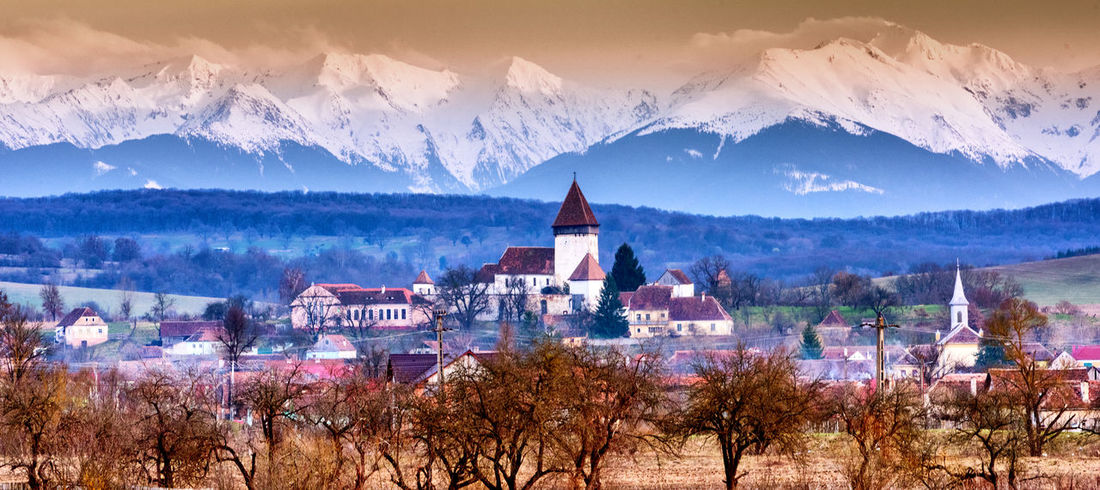 Sibiu, Romania Architecture Beauty In Nature Building Building Exterior Built Structure Cold Temperature Environment Landscape Mountain Mountain Range Nature No People Outdoors Plant Religion Scenics - Nature Sky Snow Snowcapped Mountain Tree Winter