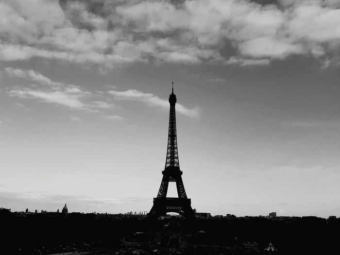Silhouette Eiffel Tower Against Cloudy Sky