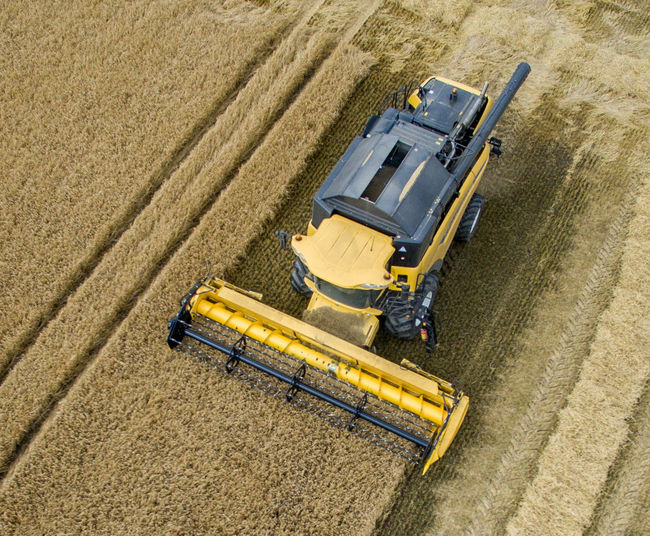 High Angle View Of Combine Harvester On Wheat Farm