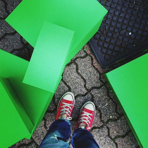 Low section of person standing by green blocks