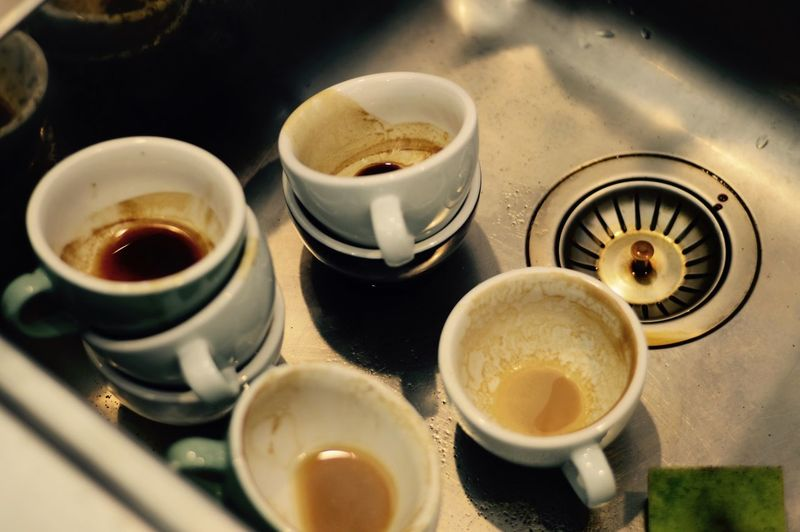 High Angle View Of Coffee Cups In Sink