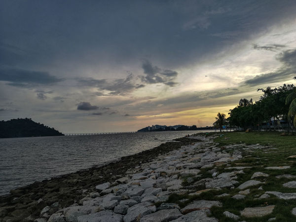 Alone #penang Clouds And Sky #JustMe #EyeEmNewHere #eyeemmalaysia #eyeemphotography #Newbie #eyemnew #queenbaymall #malaysia #rilex Shades Of Winter Tree Cloud - Sky Nature Beach Outdoors Sunset No People