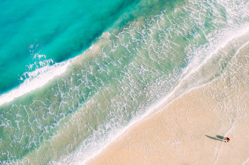 Water Motion Sea Nature High Angle View Land Wave Sport Aquatic Sport Surfing Day Beach Beauty In Nature Sand People Outdoors Aerial View Travel Destinations Turquoise Colored