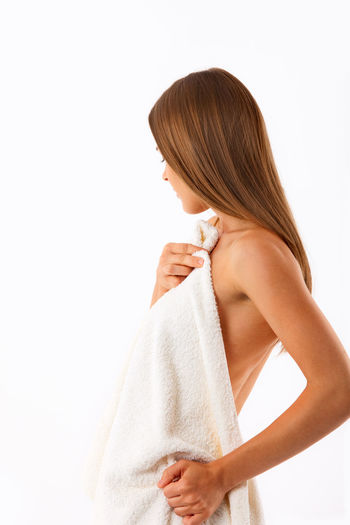 Body care Hair Lifestyle Natural Beauty Wellness After Shower Bathroom Beauty Body Care Hair Care Holding Holding Towel Lifestyles Natural Cosmetics Shampoo Shower Skincare Spa Studio Shot Towel White Background Woman With Towel Women Young Women