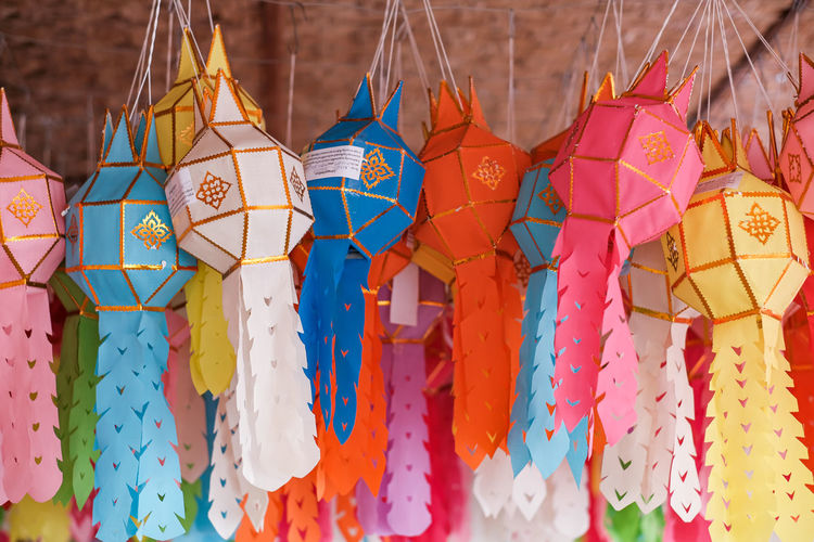 Close-up of multi colored hanging for sale in market