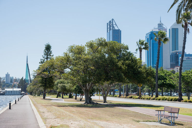 November 17,2016: Urban skyline with Swan Bell Tower and Swan River foreshore footpath in downtown Perth, Western Australia. Architecture Architecture Bell Tower Building Exterior Built Structure City Cityscape Clear Sky Day Footpath Landscape Modern No People Outdoors Perth River Sky Skyline Skyscraper Swan Bell Tower Swan River Tourism Travel Destinations Tree
