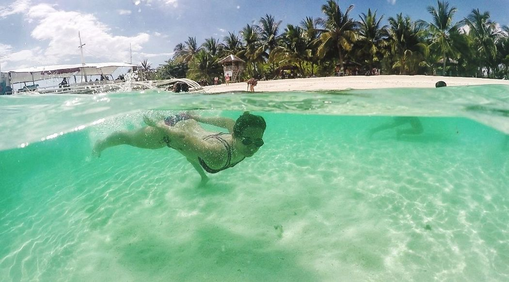 Sea Tropical Climate Sand Fish Water Animal Wildlife UnderSea Swimming Beach Tree Sea Life Underwater Nature Travel Destinations Cloud - Sky People Human Body Part Day Outdoors Beauty In Nature