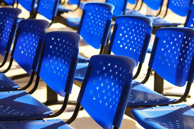 Arrangement of empty chairs in auditorium