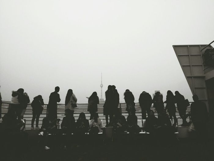 Crowd At Wuhan Yangtze River Bridge Against Clear Sky