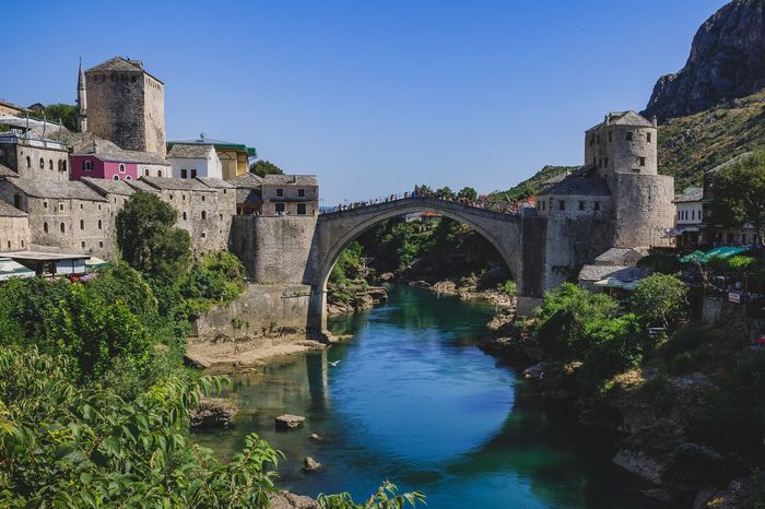 Bridge of Mostar Bosnia And Herzegovina Mostar Old Town Architecture Built Structure Arch Blue History Water Clear Sky Outdoors Day River Bridge - Man Made Structure Travel Destinations Building Exterior Tree Nature Sky