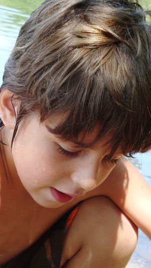 Close-up of cute boy playing in water