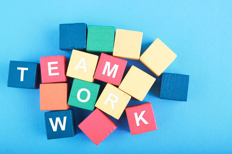 TEAMWORK word on wooden cube over blue background Multi Colored Blue Indoors  Close-up Toy Variation No People Toy Block Studio Shot Choice Creativity Still Life Group Of Objects Large Group Of Objects Blue Background Shape Geometric Shape Directly Above Design