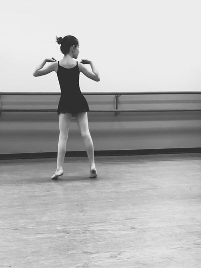 Rear View Of Girl Practicing Ballet At Studio