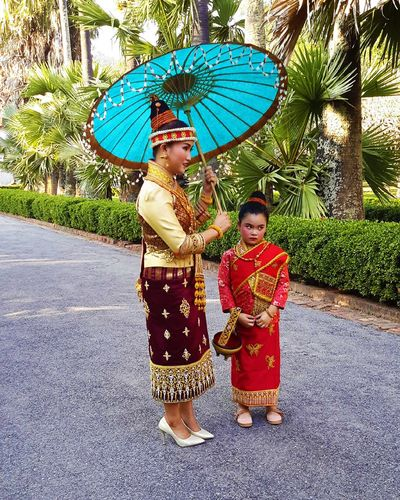 Real People Traditional Clothing Umbrella Child Full Length Two People Clothing Holding Females Childhood Standing Women Protection Togetherness Day Girls Outdoors Innocence Folklore Style Asiatic People Laos Street Street Photography