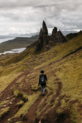 Adult Adults Only Beauty In Nature Cloud - Sky Day Full Length Hiking Landscape Mountain Nature Old Man Of Storr One Man Only One Person Outdoors People Rear View Scenics Schottland Scotland