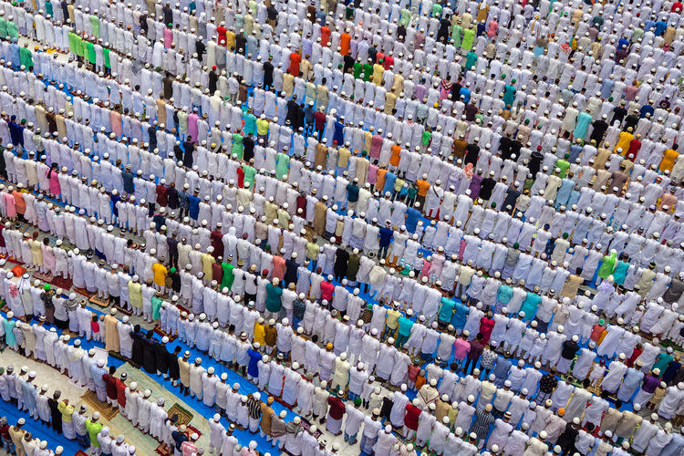 High angle view of islamic men praying outdoors