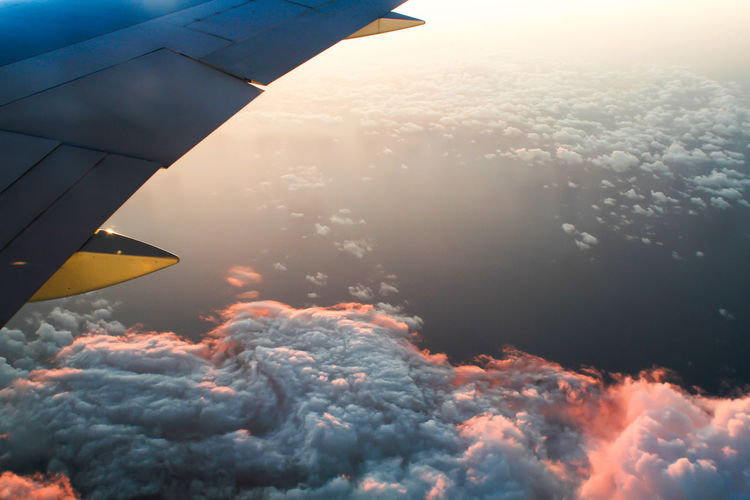 Aerial View Aircraft Airplane Cloud Cloud Clouds And Sky Cloudscape Heaven Homesick  Journey Lens Flare Majestic Ocean Orange Color Scenics Silhouette Sky Sun Sunset Top Perspective Wing