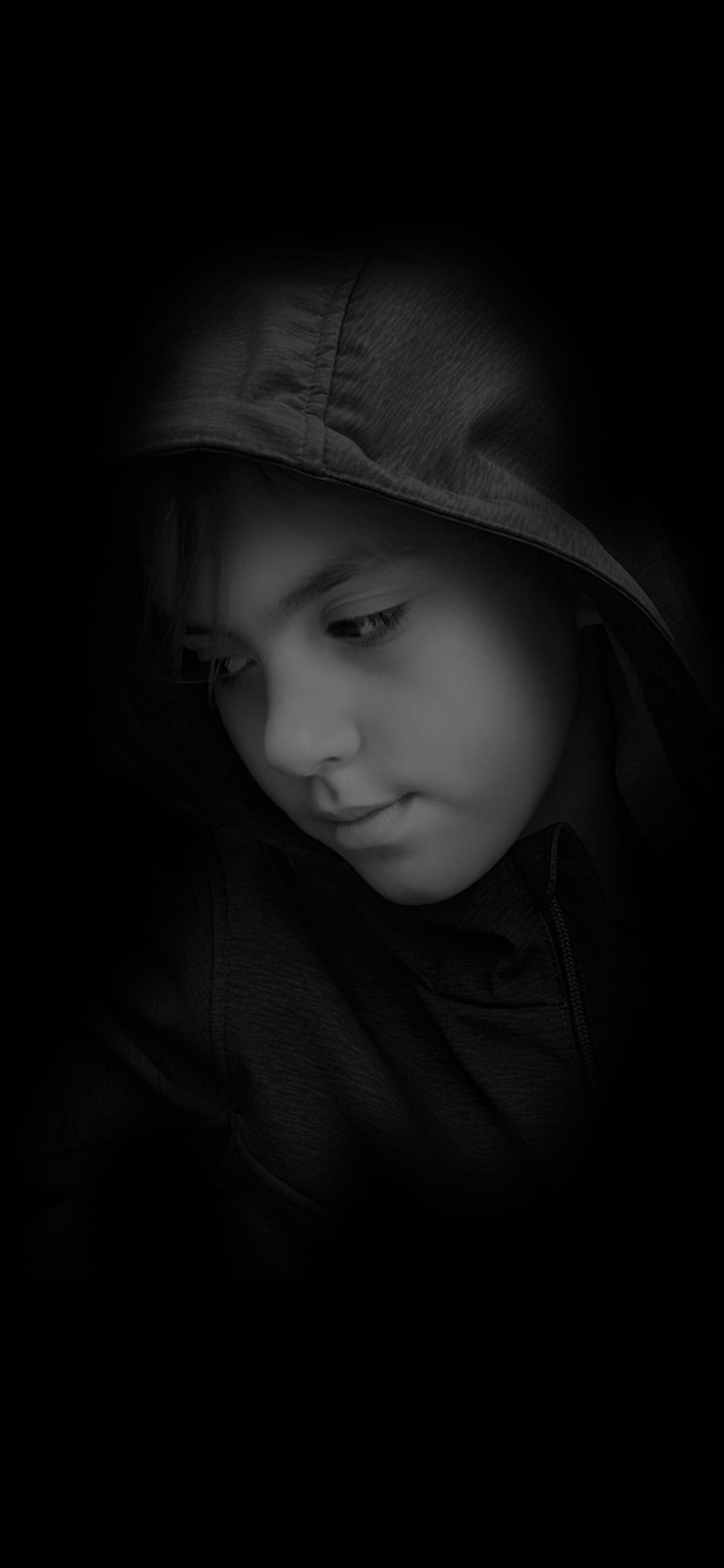 childhood, child, one person, portrait, headshot, indoors, boys, innocence, cute, lifestyles, girls, front view, real people, men, males, dark, close-up, hood - clothing, black background, contemplation