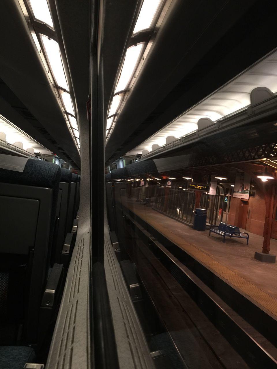 transportation, rail transportation, railroad station, railroad station platform, public transportation, railroad track, indoors, train - vehicle, illuminated, subway train, no people, day