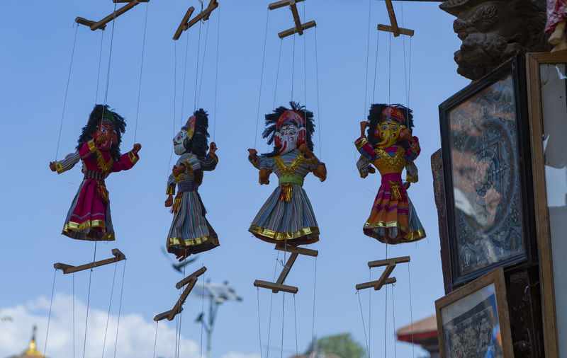 Low angle view of decoration hanging against sky