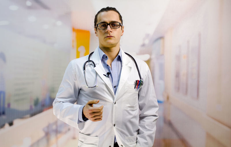 Portrait Of Male Doctor Standing In Hospital