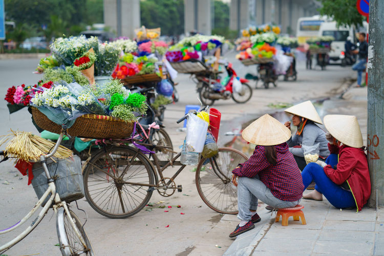 Color of life - In VietNam, many people are earning to livelihood by selling on the street. Colors Hanging Out Relaxing Rest Time Vietnam Street View Bicycle Color Of Life Flowers On The Basket Flowers, Fowers Hanoi Vietnam  Hanoi City Tour Hanoi Street Hanoi Street Food Hanoi Tour, Outdoors People Selling Flowers Selling On The Road, Selling On The Street, Selling, Transportation Vietnamese Hat, Vietnamphotography Women First Eyeem Photo