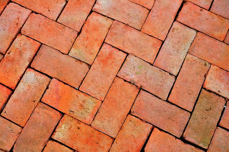 The brown brick outdoor floor, background Full Frame Backgrounds Pattern Textured  No People High Angle View Paving Stone Geometric Shape Brown Brick Flooring