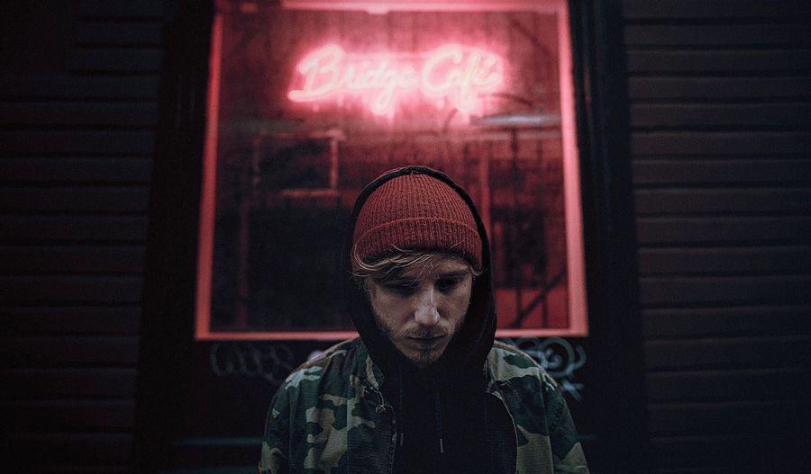 Mid adult man in illuminated room