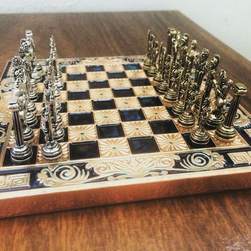 High angle view of chess pieces on table