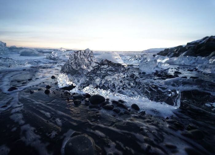 Scenic view of ice in sea against sky during winter