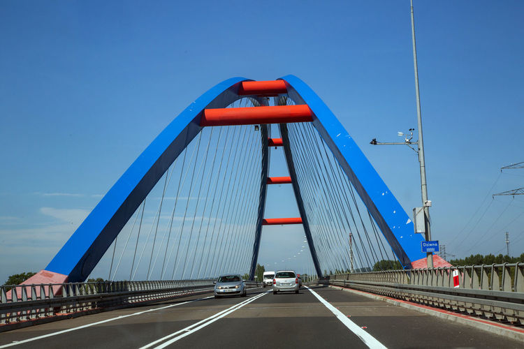 Architecture Blue Bridge Bridge - Man Made Structure Built Structure Car Clear Sky Connection Direction Engineering Land Vehicle Mode Of Transportation Motor Vehicle Nature Outdoors Road Sky Suspension Bridge The Way Forward Transportation Travel