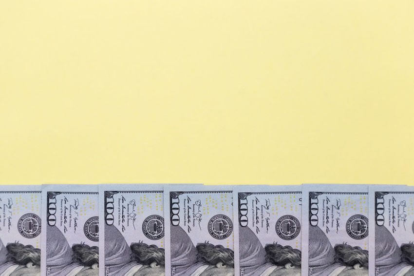 american dollars on a color background - banknotes of hundred dollar bills Mockup Accounting American Budget Business Copy Space Currency Economy Jackpot USD Background Cash Colorful Copy Space Credit Dollar Dollars Finance Financial Money No People Savings Tax Yellow Yellow Background American One Hundred Dollar Bill Investment Exchange Rate Currency Symbol Financial Item