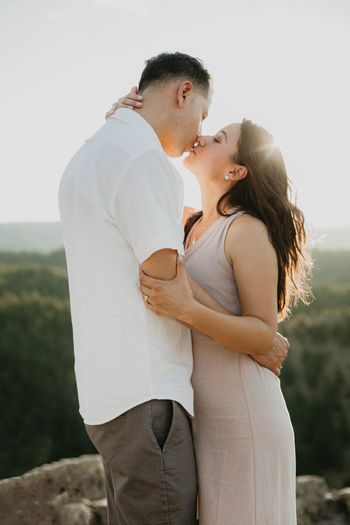 Side view of a couple kissing outdoors